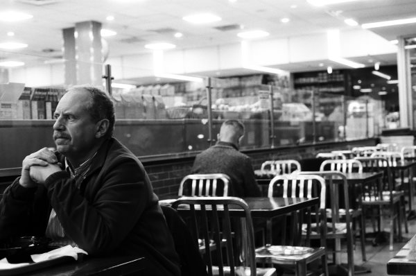 Man alone at midnight in a café (New York City)